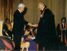1989 - Sir Raymond Hoffenberg (right) (former President, Royal College of Physicians of London) receiving his award from DYMM Yang Di-Pertuan Agong, Sultan Azlan Shah